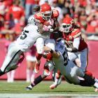 Dexter McCluster of the Kansas City Chiefs gets sandwiched on a punt return against the Oakland Raiders.