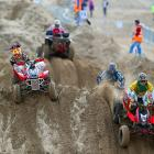 Riders climb over the dunes during the adult quad and sidecar race in the RHL Beach Motorcycle Race in Weston Super Mare, United Kingdom.