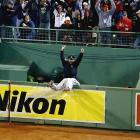 Torii Hunter comes up short trying to catch a grand slam hit by David Ortiz to tie Game 2 of the ALCS. Ortiz's homer tied it 5-5 in the bottom of the 8th, and Jarrod Saltalamacchia hit a walk off single to tie the series.