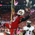 Louisville safety Calvin Pryor intercepts a pass against Central Florida. The Knights scored with 23 seconds remaining to upset the No. 8 Cardinals.