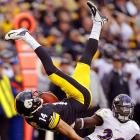 Pittsburgh Steelers wide receiver Derek Moye is upended by Baltimore Ravens safety Matt Elam. Pittsburgh knocked off Baltimore to climb to 2-4 and stay alive in the AFC playoff hunt.