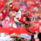 Houston Texans safety Shiloh Keo flips Kansas City Chiefs wide receiver Dwayne Bowe. The Chiefs beat the Texans 17-16 to move to 7-0 and sit as the last undefeated team in the league.