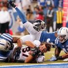 Denver Broncos wide receiver Eric Decker loses his helmet as he makes a catch against the Indianapolis Colts. The Colts spoiled Peyton Manning's homecoming, topping the Broncos 39-33.