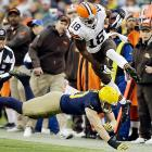Cleveland Browns wide receiver Greg Little hurdles Green Bay Packers linebacker A.J. Hawk after a catch. The Packers won 31-13 to move to 4-2 and remain in control of the NFC North.