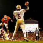 Florida State quarterback Jameis Winston unleashes a pass on the road against No. 3 Clemson. Winston completed 22 of 24 passes for 444 yards and three TDs as the Seminoles upset the Tigers 51-14.