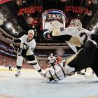 A shot off the stick of Philadelphia Flyers forward Wayne Simmonds gets past Pittsburgh Penguins goalie Marc-Andre Fleury.