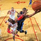 Orlando Magic forward Maurice Harkless elevates over Houston Rockets center Dwight Howard during a preseason game.
