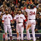 David Ortiz celebrates with Dustin Pedroia after hitting a two-run homer.