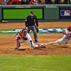 Pete Kozma scores the tying run in the seventh inning.