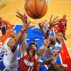 Heat center Chris Andersen fights for a rebound against 76ers forward Lavoy Allen.