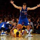 Clippers forwards Blake Griffin and Matt Barnes scramble for a loose ball against the Lakers.