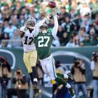 Jets cornerback Dee Milliner breaks up a pass intended for Saints wide receiver Robert Meachem. The Jets upset the Saints 26-20 to move to 5-4 on the season.