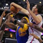 Warriors center Jermaine O'Neal draws contact from Clippers big men Byron Mullens, right, and DeAndre Jordan, left. The high-scoring Clippers won 126-115.