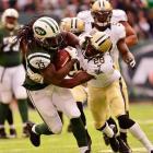Jets running back Chris Ivory stiff arms Saints cornerback Keenan Lewis.