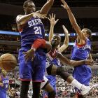 Washington Wizards point guard John Wall sneaks a pass around 76ers forward Thaddeus Young.