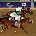Jockey Gary Stevens, top, rides Mucho Macho Man to victory in the Breeders' Cup Classic, ahead of Will Take Charge, bottom, and Declaration of War at Santa Anita Park, in Arcadia, Calif.