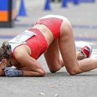 This week's inspirational image: A weary runner's face-plant and grateful smooch of the cement after arriving seventh in the women's division of the New York City marathon.