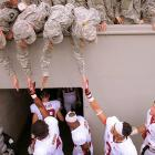 Stanford football players high-five Army members while leaving the field after playing at Army in September. Stanford beat the Black Knights 34-20.