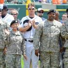 Tigers right fielder Brennan Boesch applauds members of the military during a ceremony to honor Memorial Day at Detroit's game against the Twins in 2011.