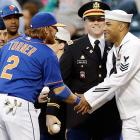 Mets second baseman Justin Turner shakes hands with members of the military after some of them threw out the ceremonial first pitches at New York's Military Appreciation Night in May.