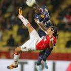 Monaco's Falcao jumps for the ball with Evian's Jonathan Mensah during their French League One soccer match.