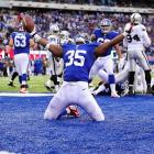 Giants running back Andre Brown celebrates after scoring a touchdown against the Raiders. The game Sunday was Brown's first this year after suffering a broken leg in the preseason.