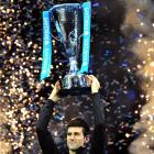 Novak Djokovic holds the Brad Drewett Trophy after beating Rafael Nadal in the singles final at the ATP World Tour Finals.