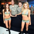 Worth fighting for, no? Vanessa Hanson (left) and Chrissy Blair (right) schmoozed with members of the U.S. Army during the UFC Fight for the Troops event in Fort Campbell, Kentucky.