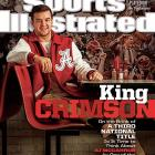 The tattoo on his chest says it all ? A.J. McCarron is a Bama Boy. Alabama is once again undefeated, and looking to add a third straight national championship trophy to the display case. That's more than enough to land the Crimson Tide's leader, McCarron on the cover of SI. L. Jon Wertheim takes a deep dive in McCarron's life, chronicling how the Tide QB went from trailer parks to unrepentant gunslinger to a turnover-averse game manager.