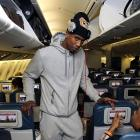 Iman Shumpert stretches in the isle as the Knicks travel to London for a game against the Pistons.