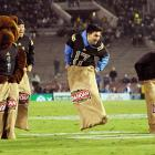 UCLA fans had a bag on in the Idahoan potato sack race during the game between their Bruins and Washington's Huskies at the Rose Bowl in Pasadena, CA.