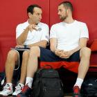 Love chats with Team USA coach during a minicamp in July 2013.
