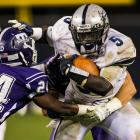 Abraham Lincoln's Leroy Hancle (5) attempts to stiff arm defensive back Javanughn Wright.