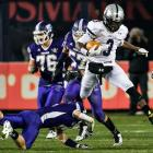 Abraham Lincoln wide receiver Malik Andrews hurdles Tottenville free safety James Munson.