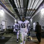 Abraham Lincoln defensive tackle Thomas Holley leads his team out of the locker room after halftime.
