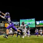 Tottenville wide receiver Brendon Murphy stretches for a pass as Abraham Lincoln free safety Jahsi Meade (16) rushes on.