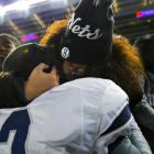 Abraham Lincoln player Nyjel West (13) celebrates with a fan.