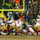 As time expires, Phil Dawson nails a 33-yard field goal to give the San Francisco 49ers a 23-20 victory over the Green Bay Packers in an NFC wild-card at Lambeau Field. The kick advanced San Francisco to the second round of the NFL playoffs.