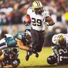 New Orleans Saints running back Khiry Robinson eludes Philadelphia Eagles defenders during an NFC wild-card game. Led by 185 team rushing yards, the Saints won a road playoff game for the first time in franchise history.