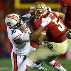 Winston tries to escape the grasp of Auburn defensive end Dee Ford, who notched two sacks during the game.