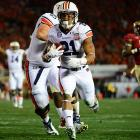 Auburn running back Tre Mason runs for the end zone after catching a pass from Nick Marshall. The score and the ensuing extra point gave the Tigers a 7-3 first-quarter lead.