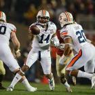 Auburn quarterback Nick Marshall pitches the ball to running back Corey Grant.