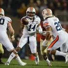 Auburn quarterback Nick Marshall pitches the ball to running back Corey Grant.