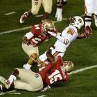 Seminoles defensive end Mario Edwards Jr. and linebacker Terrance Smith try to wrap up Auburn's Nick Marshall.