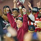 Florida State head coach Jimbo Fisher celebrates the national championship victory with his team.