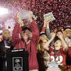 Seminoles coach Jimbo Fisher lifts The Coaches' Trophy after Florida State beat Auburn, snapping the SEC's seven-year streak of winning the national title.