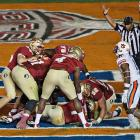 The Seminoles offense celebrates after Kelvin Benjamin came up with the decisive touchdown grab.