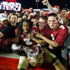 Defensive back Ronald Darby celebrates Florida State's first national championship since the 1999 season with Seminoles fans.