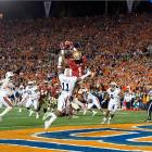 Florida State wide receiver Kelvin Benjamin catches the game-winning touchdown with only 13 seconds left on the clock.