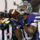 The speedy wideout caught three touchdown passes in the first half -- tying a Wildcats bowl record -- and finished with a school-record 10 receptions for 116 yards in a 31-14 Buffalo Wild Wings Bowl win over Michigan. Lockett had at least eight catches in three of Kansas State's final four games.